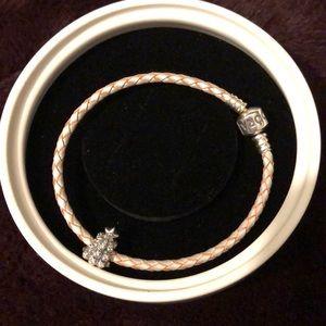 Pandora Christmas tree charm on leather bracelet.
